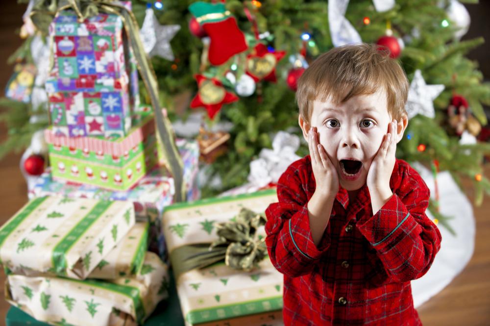 surprised happy boy children christmas morning